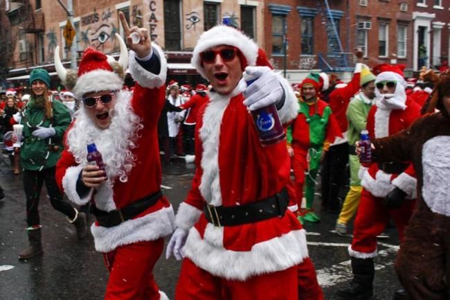 Revelers dressed as Santa Claus walk on the street during SantaCon in New York